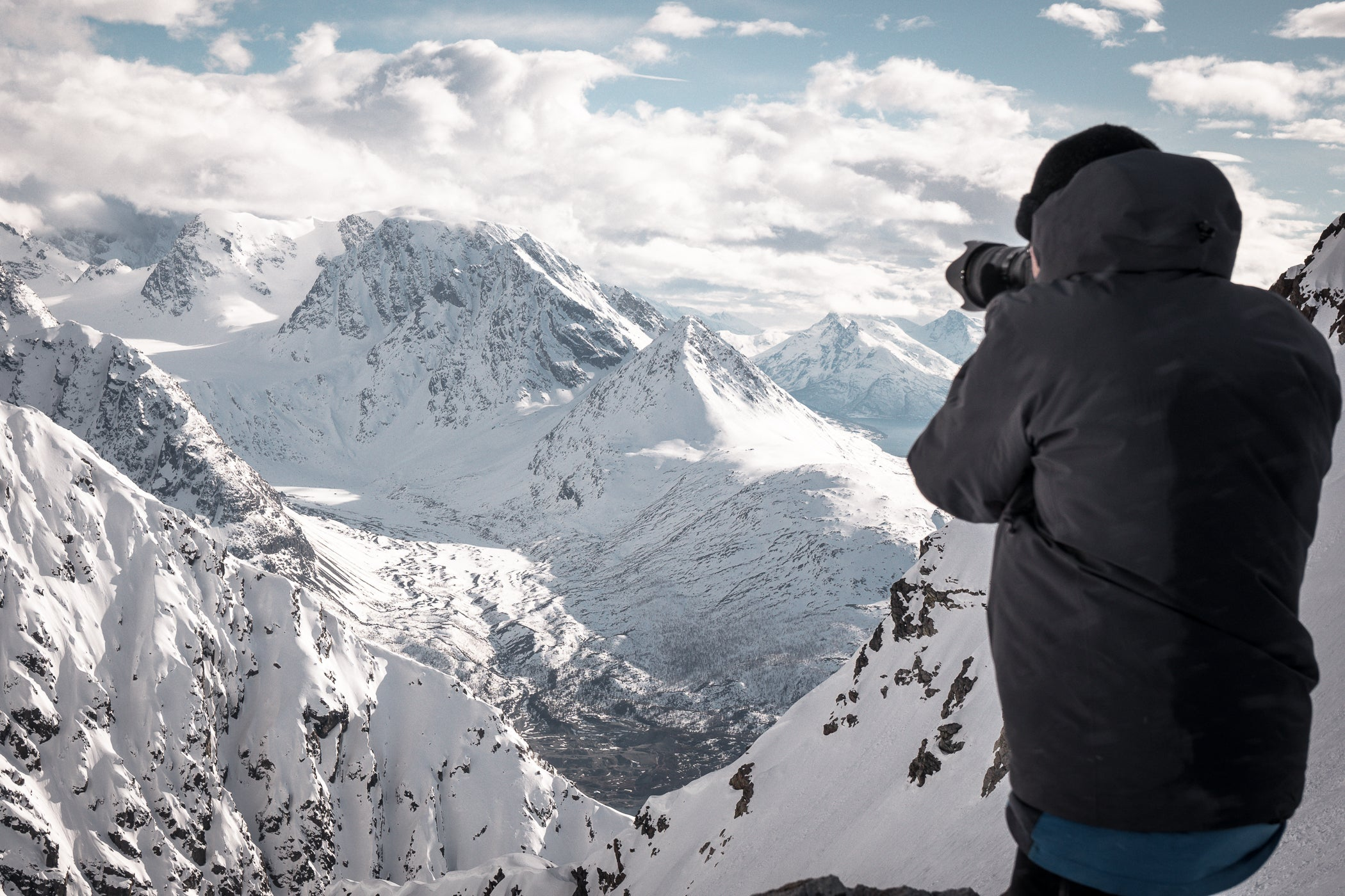 Photographer shooting the snowy mountains