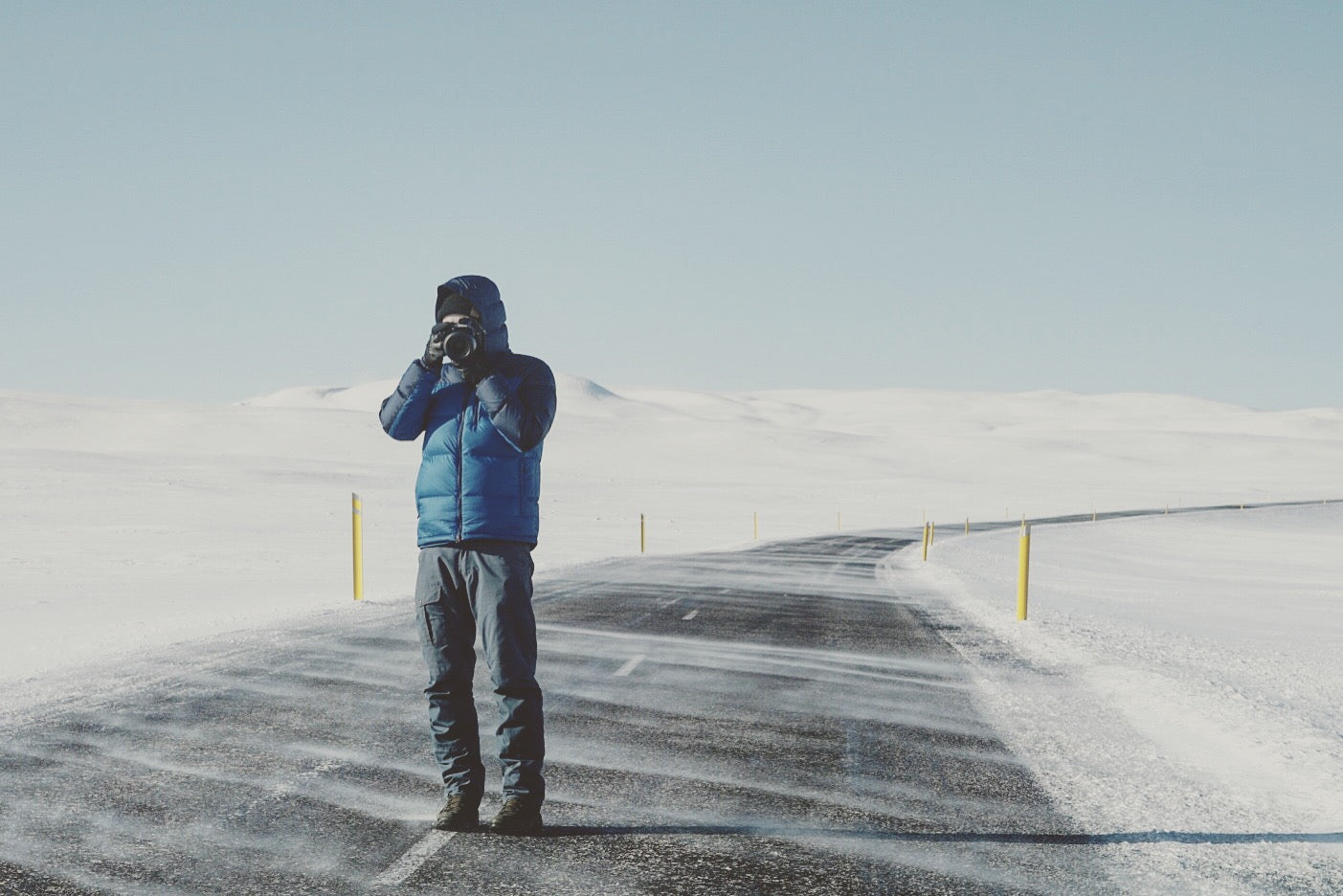 man in iceland taking photo
