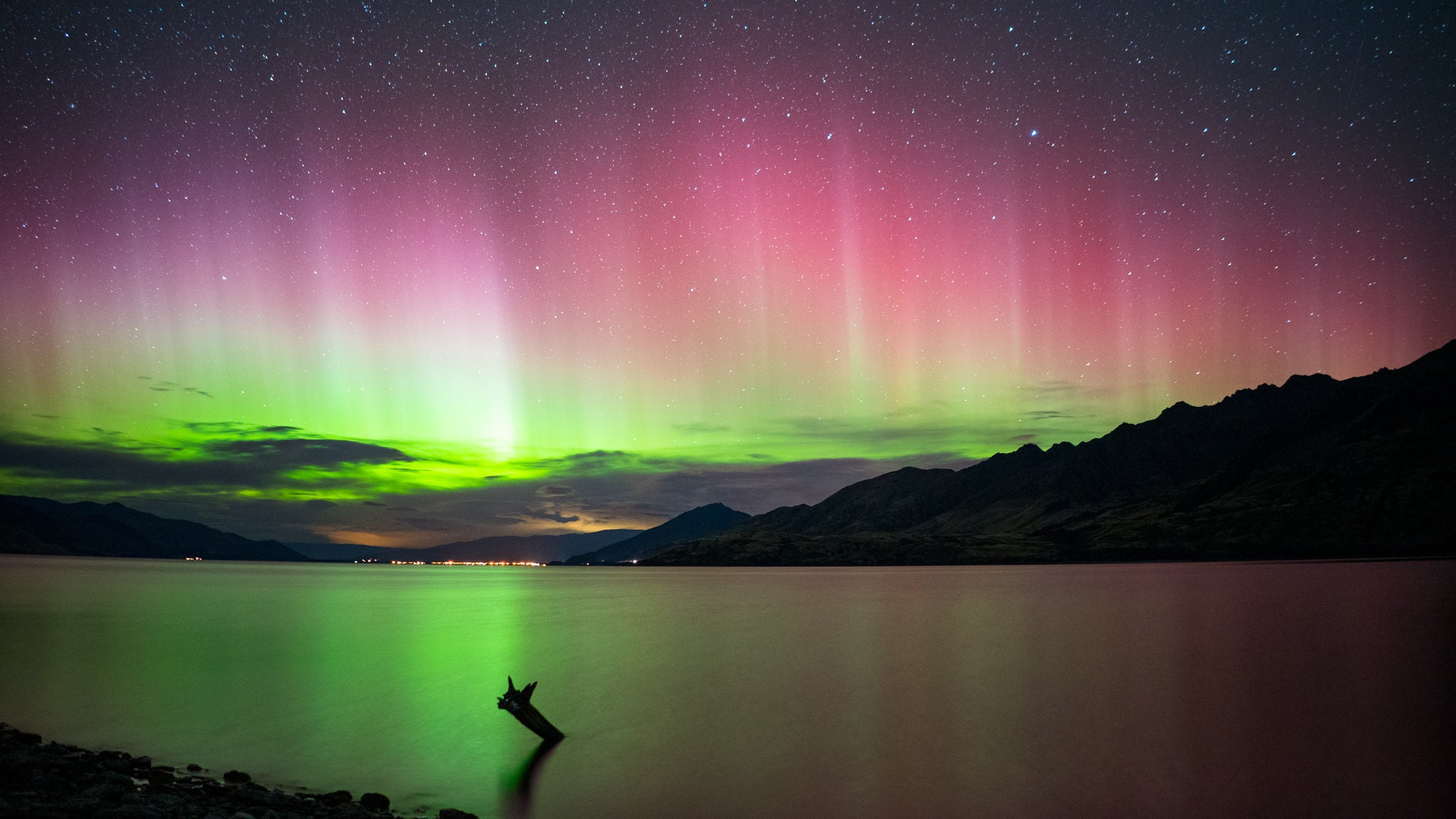 Pink and green southern light over New Zealand. Photo by Levi Harrell