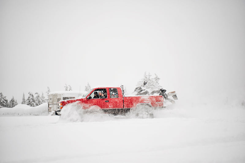 Red truck in a snow storm