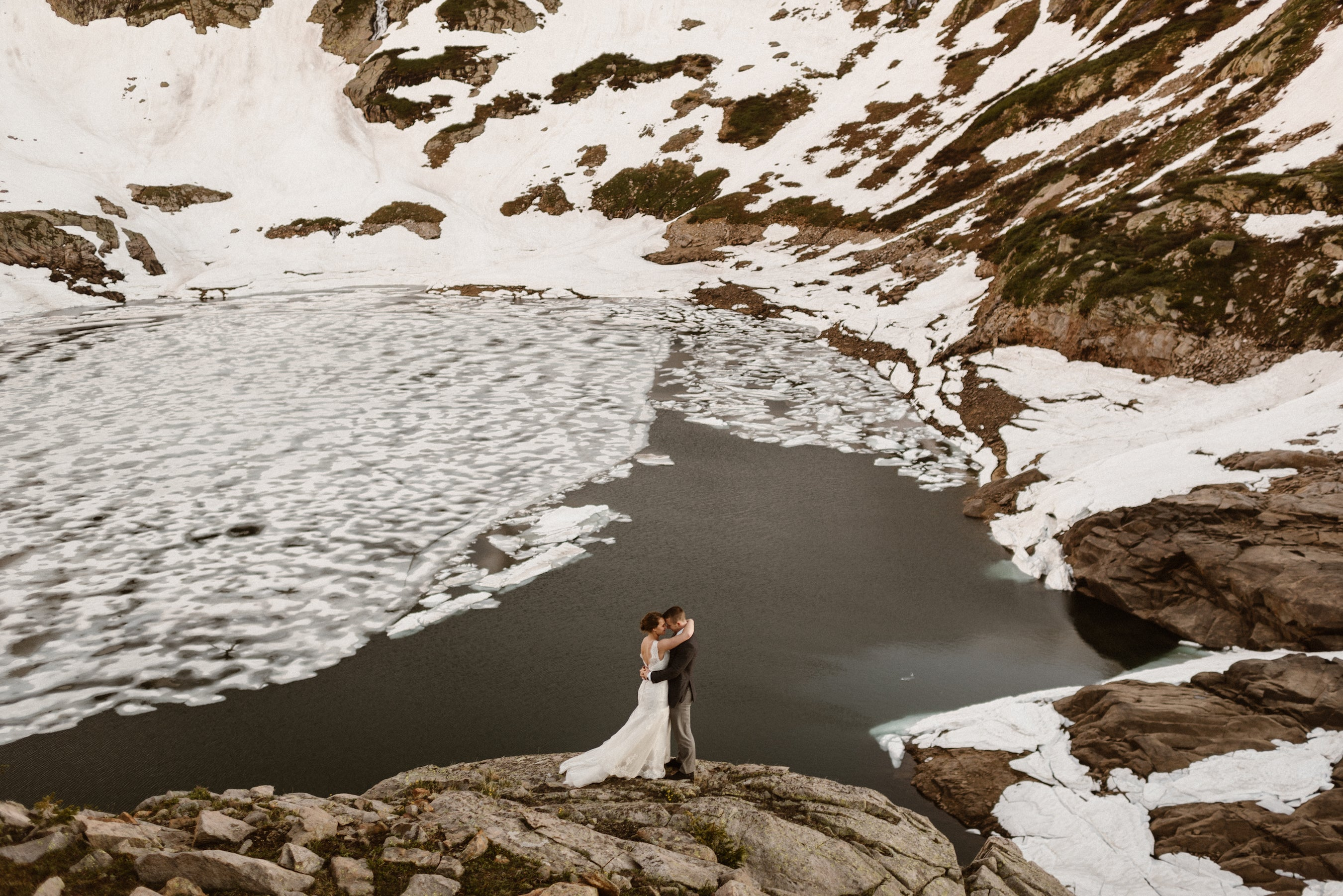 Wedding couple in front of icy lake