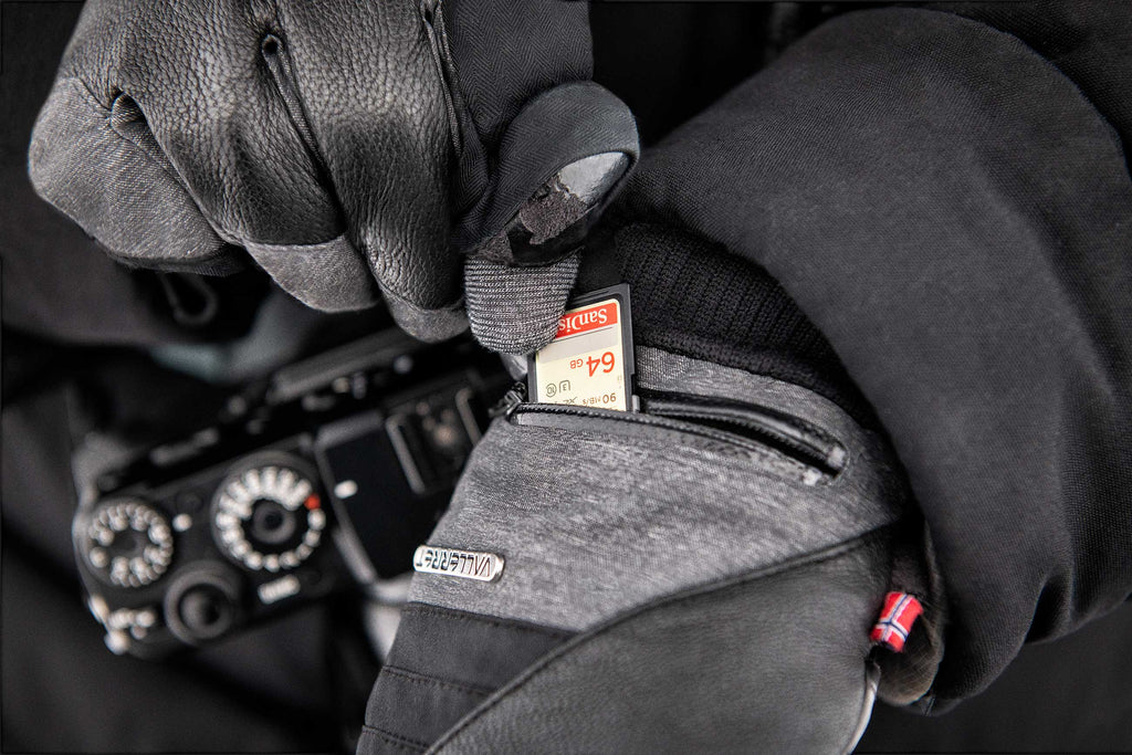 SD card stored in the pocket of a photography gloves