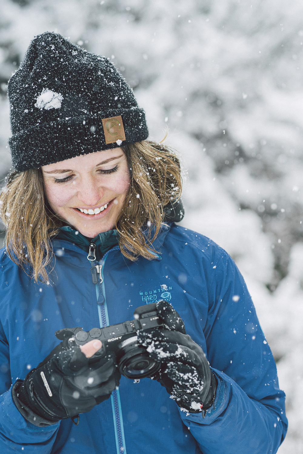 woman with a camera in the snow