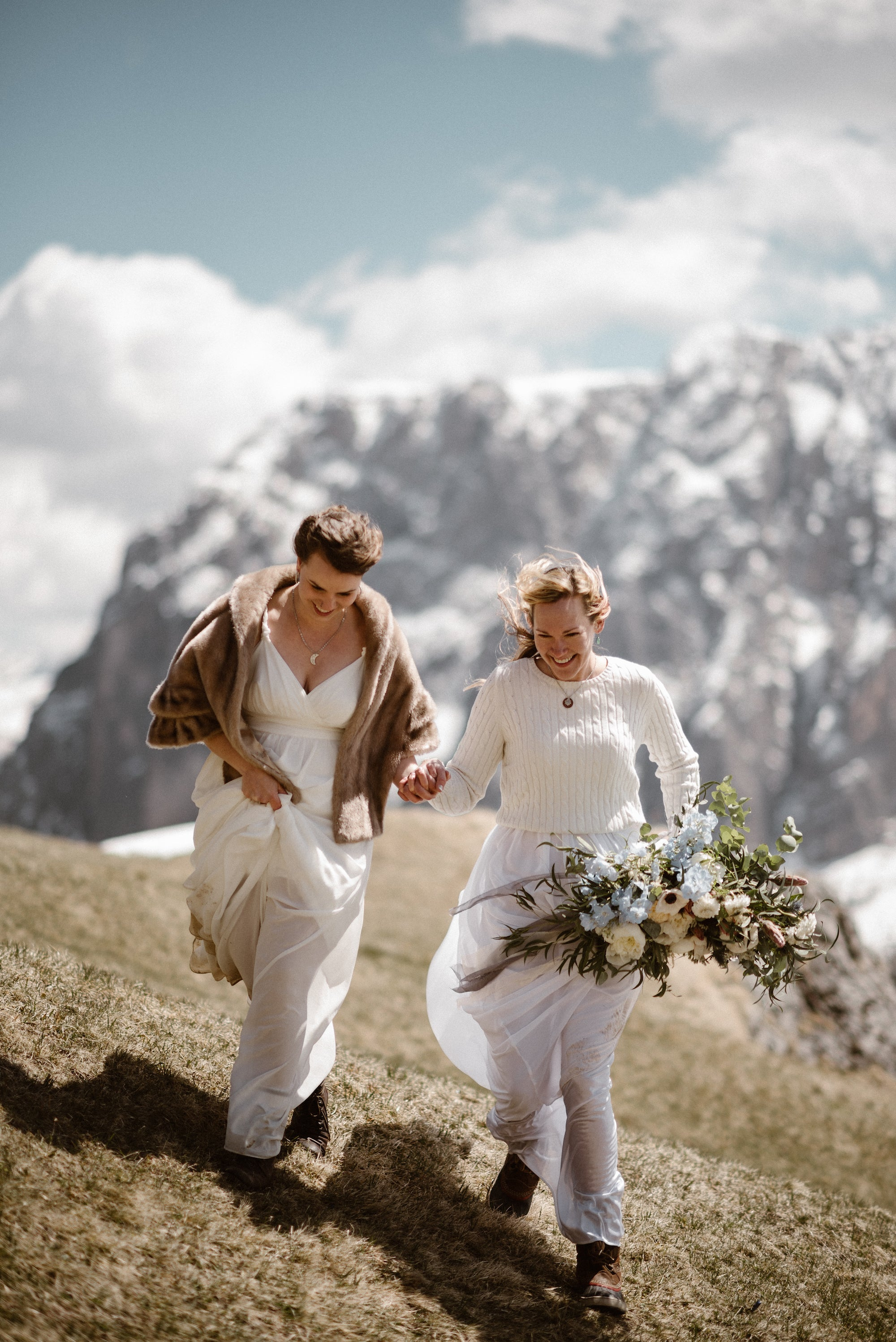 Brides eloping to alpine mountain