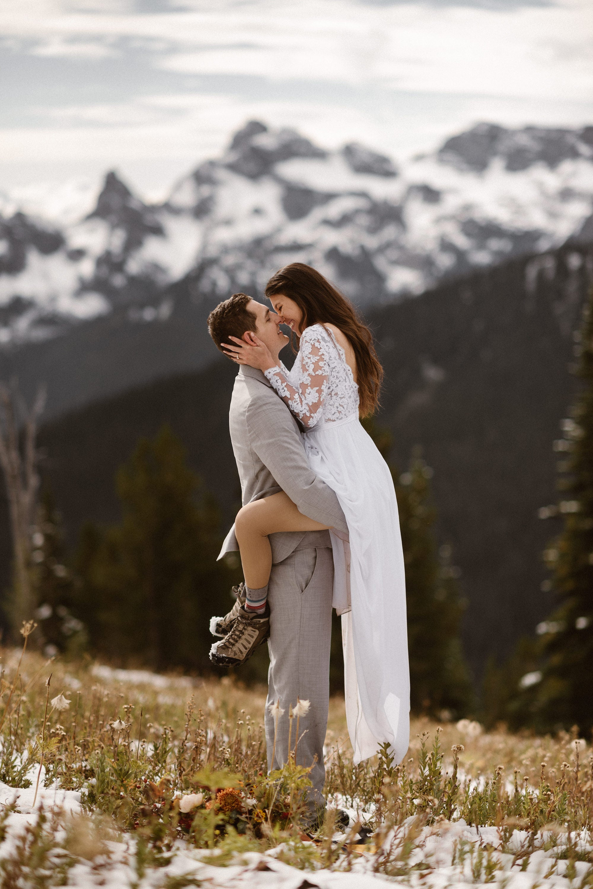 Bride and groom kissing on a mountain