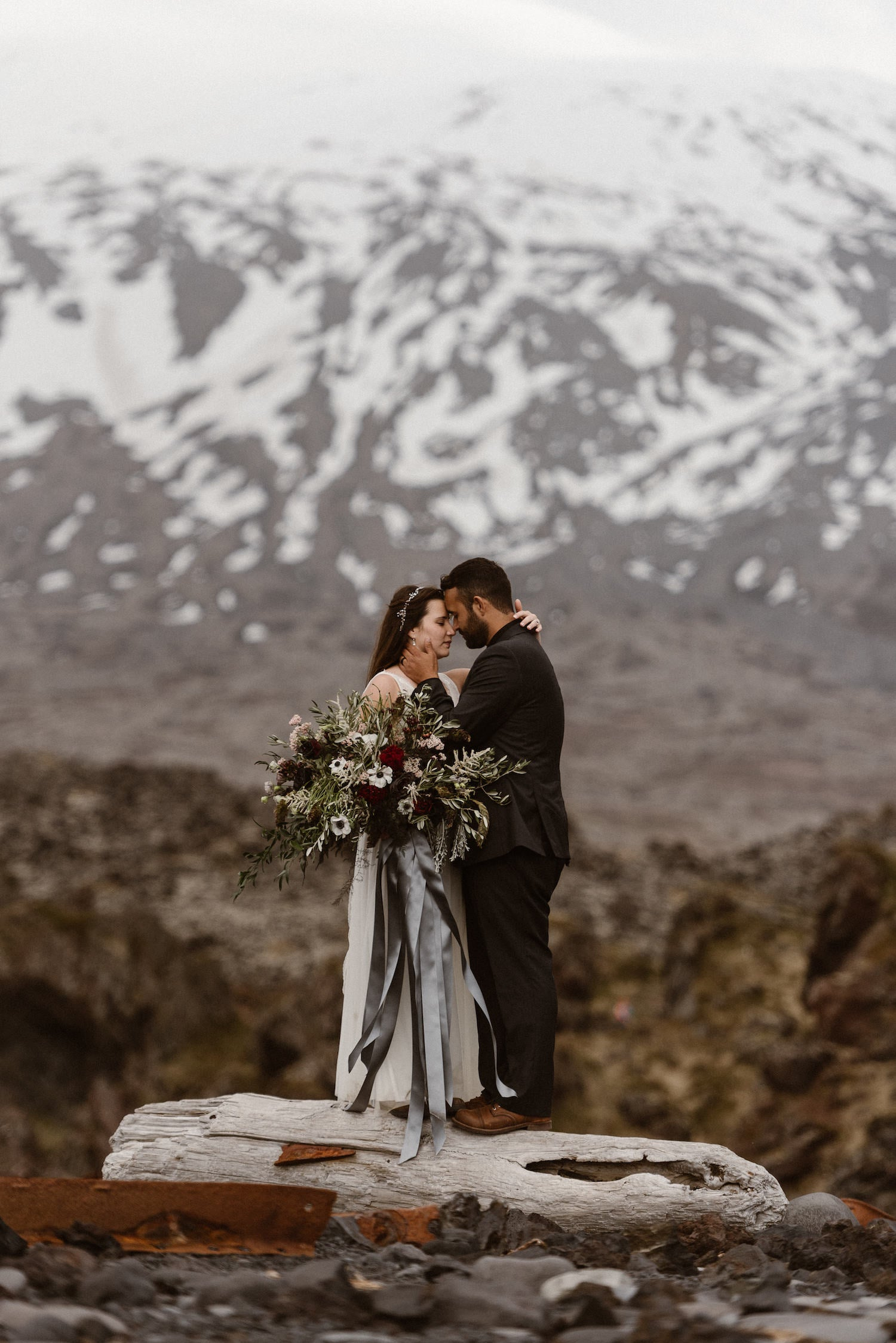 wedding couple in front of snowy mountain
