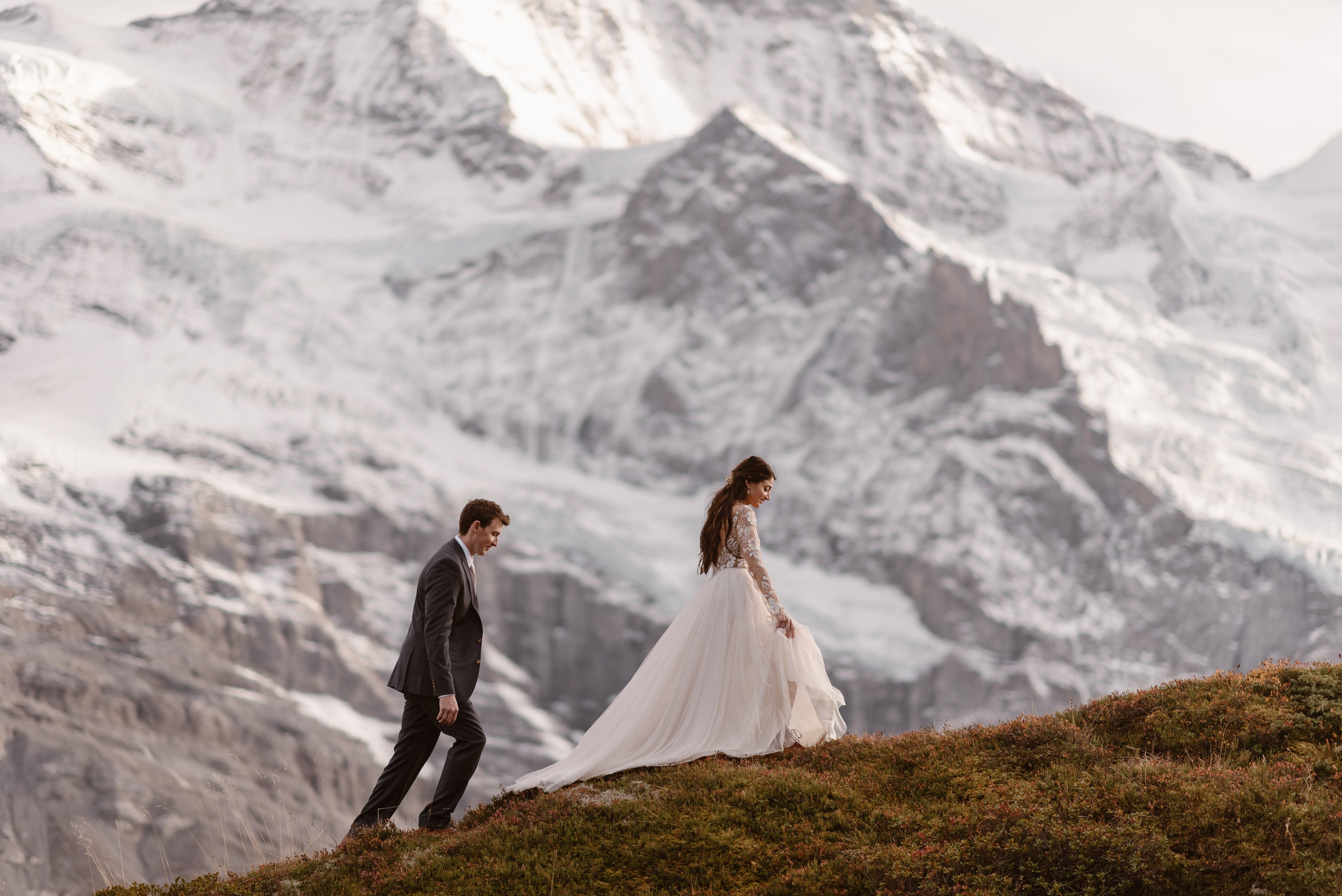 Wedding couple on snowy mountain