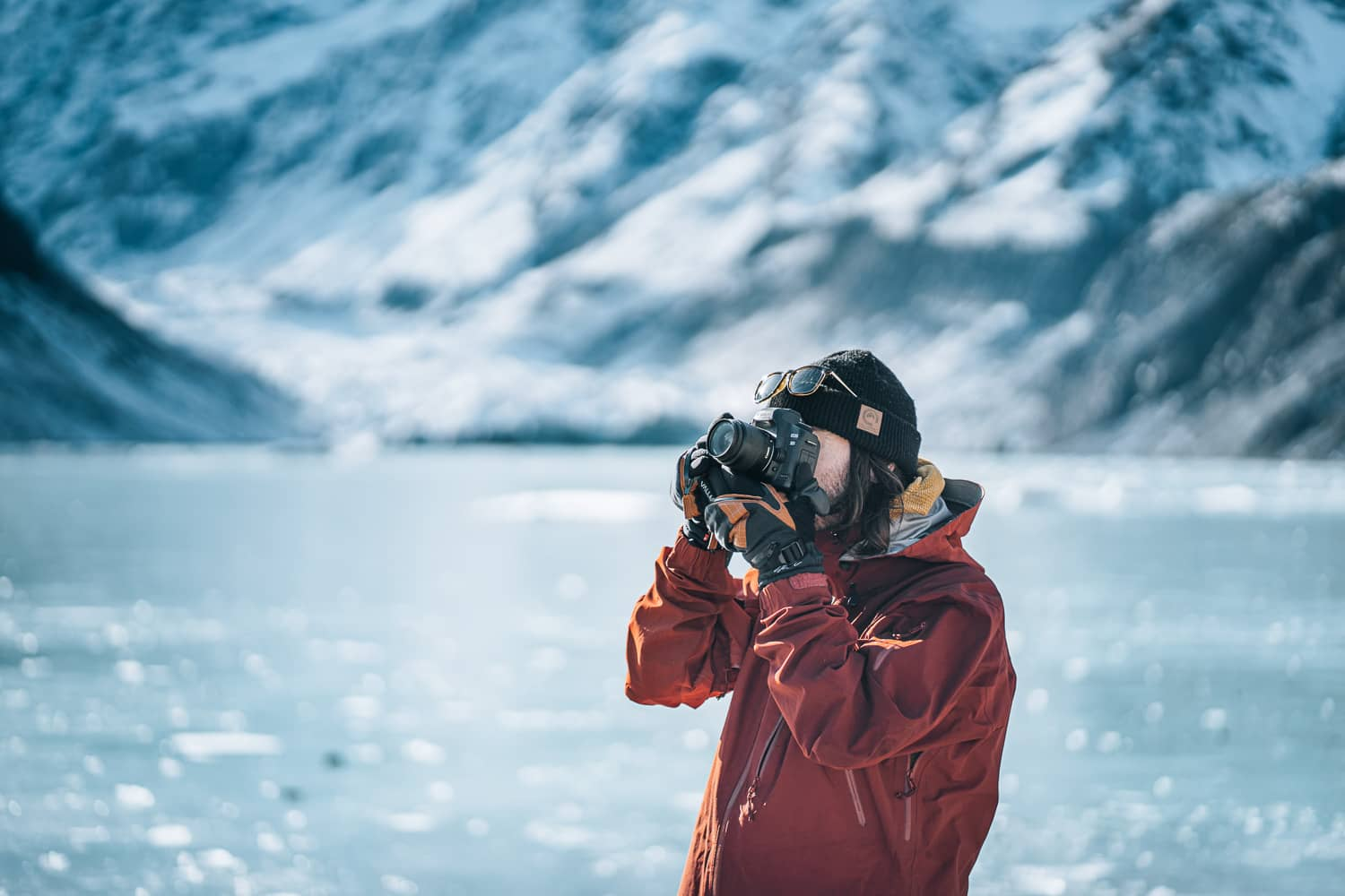 photographer in front of alpine lake