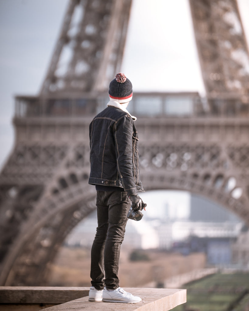 Photographer standing in front of Eiffel Tower