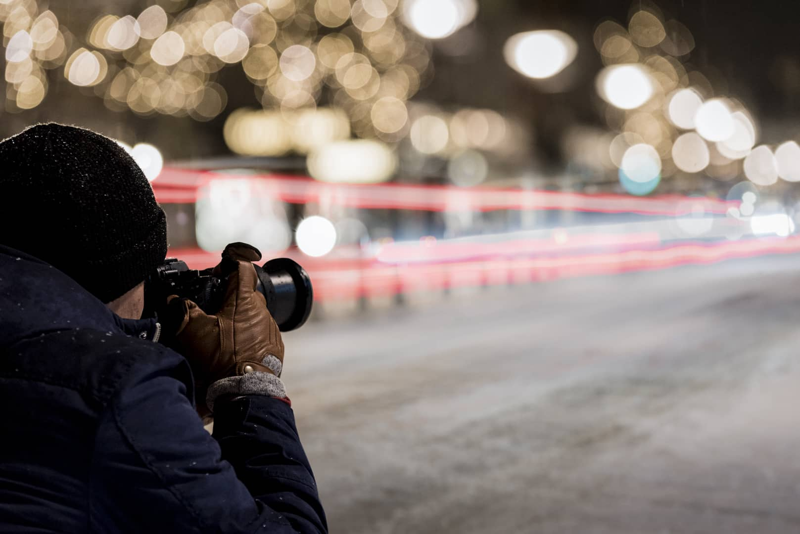 Person taking a photo of a city street in winter by Carl van den boom