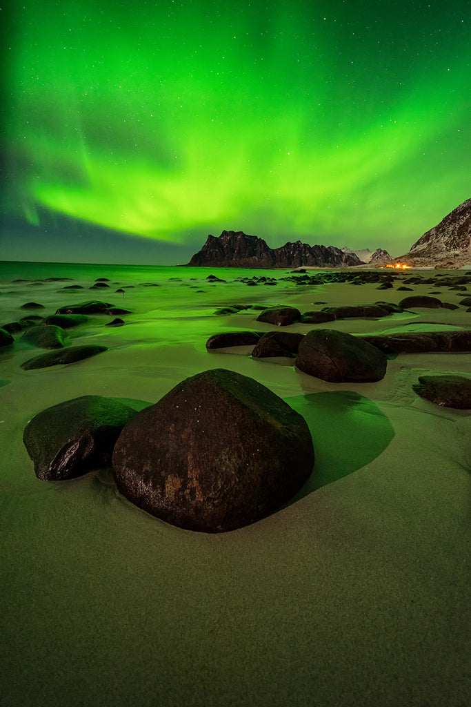 Utakleiv Beach at night with northern lights