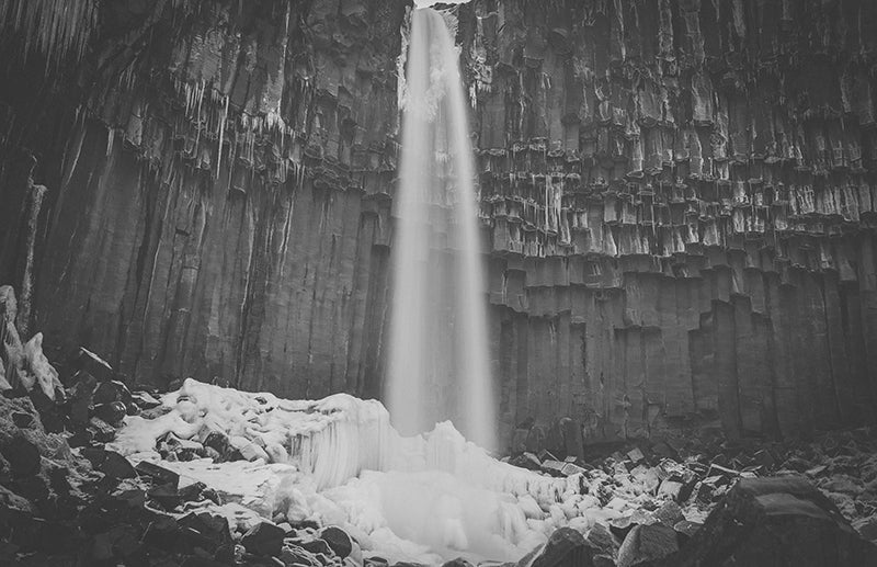 black and white photo of iceland waterfall