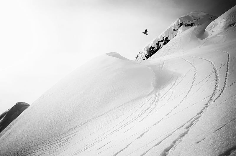 snowboarder jump in black and white