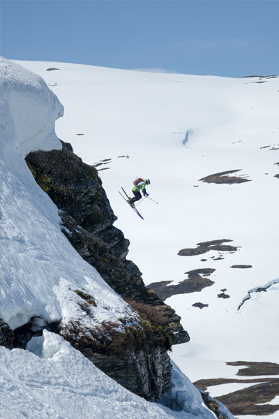 skier jumping off ledge