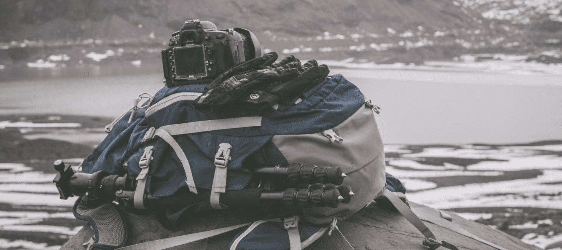 Camera bag and gear in the snow