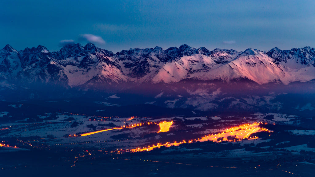 Blue hour mountains with town in front_ photo by cezary-kukowka via upsplash