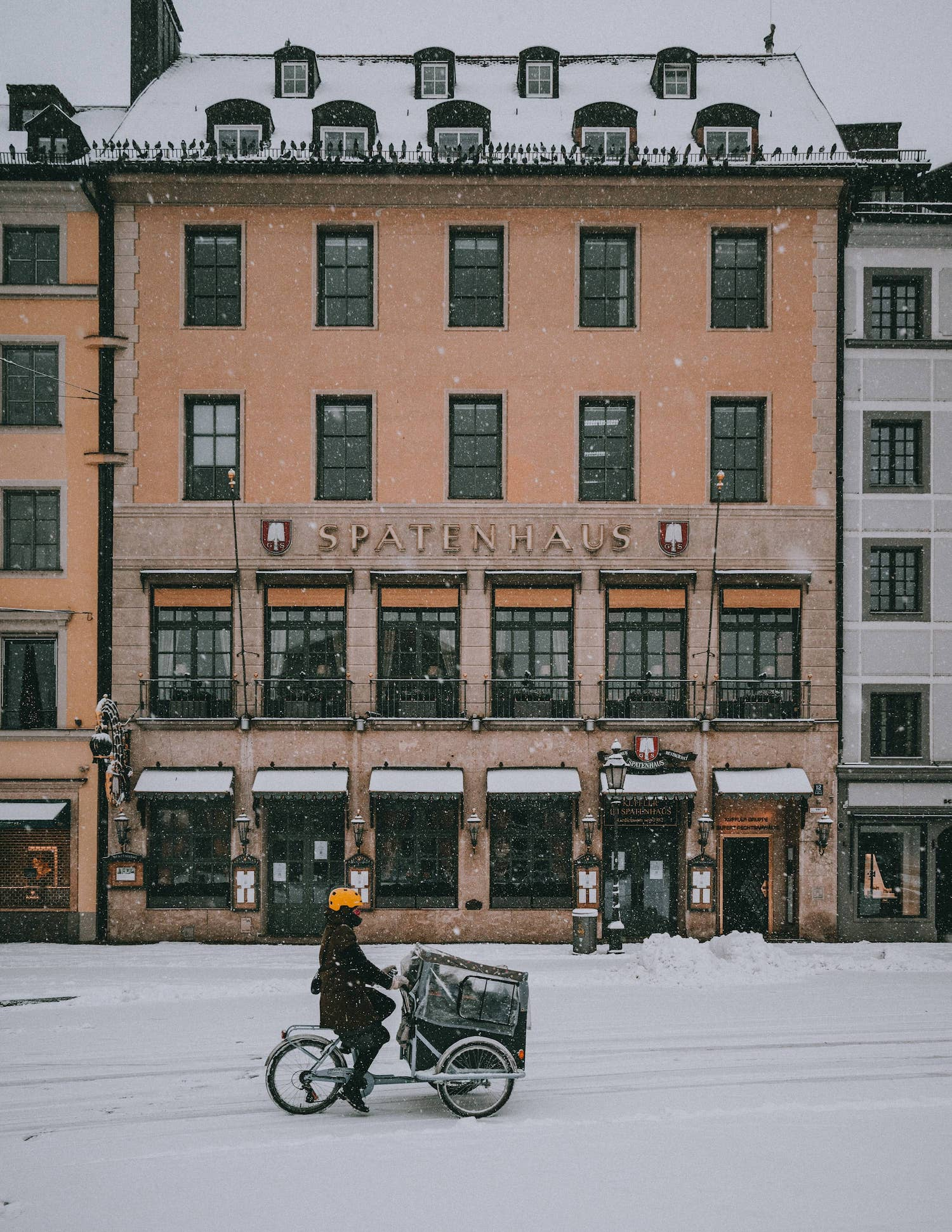 bicycling in snowy city streets