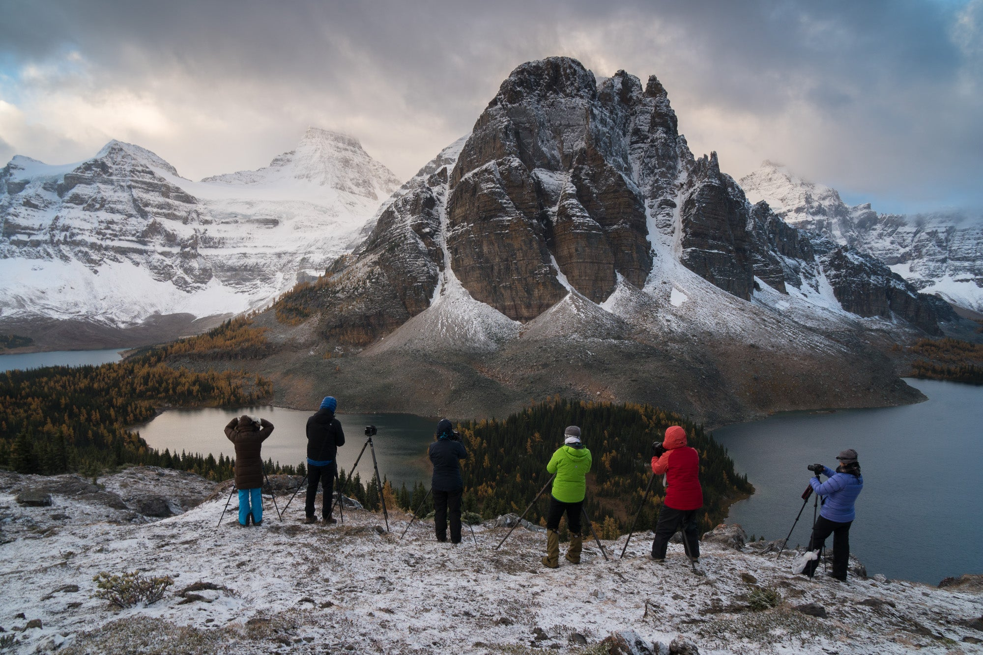 photographers photographing a mountain in the winter