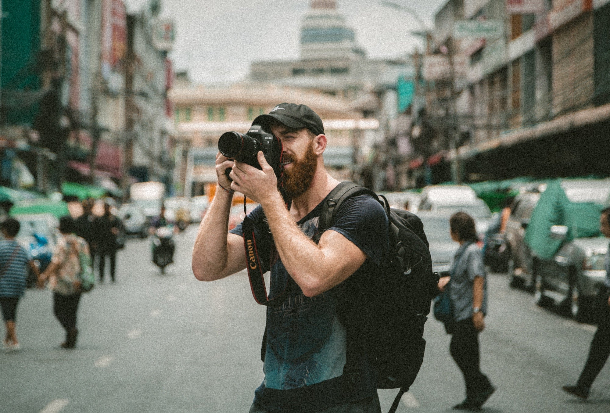 man taking a photo in an urban area