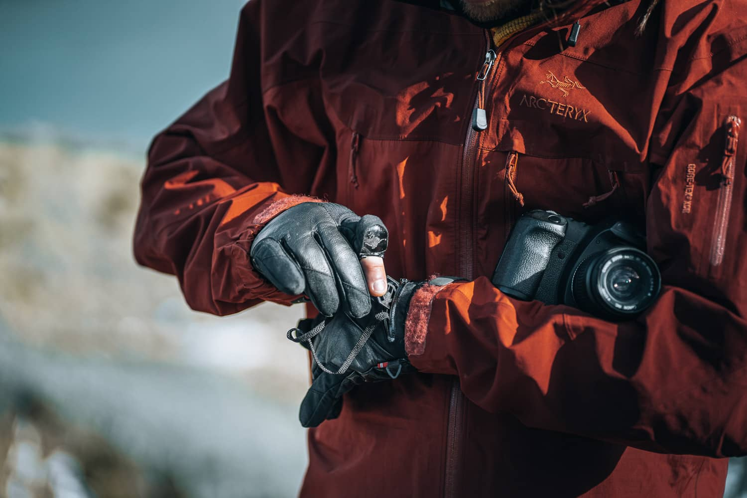 photographer wearing gloves with a pocket