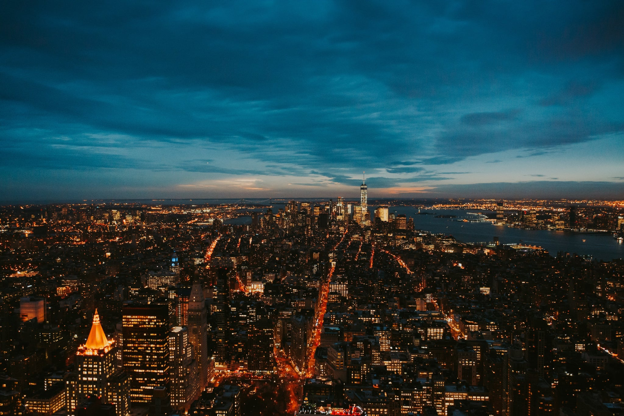 Ariel shot of an urban landscape at dusk. Photo by Z S on Unsplash