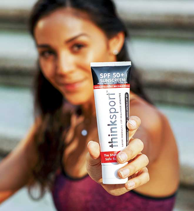 Thinksport Sunscreen Held by Julana