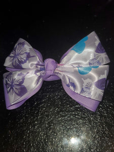 Light Purple Hair Bow With A White Butterfly Print Satin Ribbon Stacked On Top Barrette