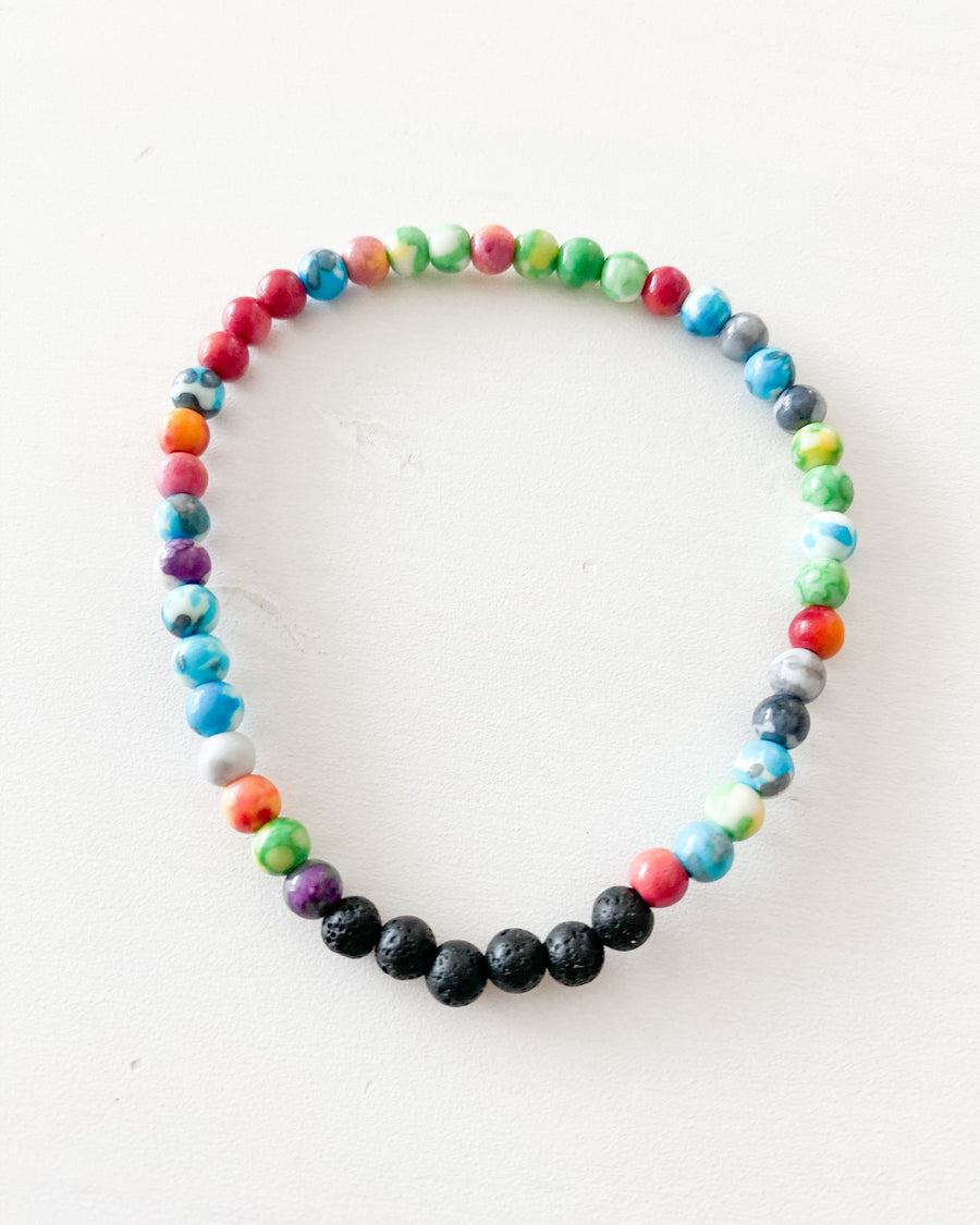 Mini Oil stone beaded bracelet. Four lava mini beads hold all your oil scent and is designed with mini multi colored stone beads to make that perfect arm party.