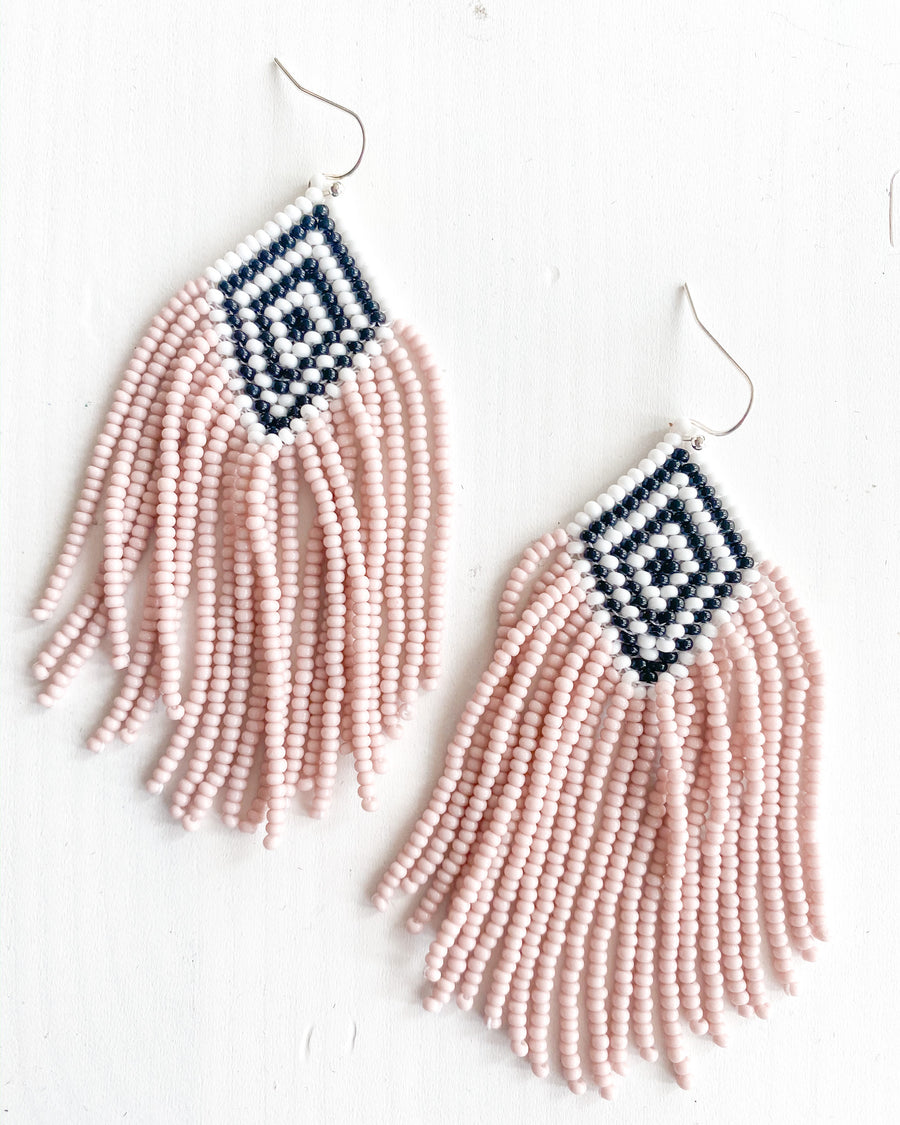 Pink seed beads earrings. With black and white diamond design up top and stainless steal hooks for your ears made by artisans