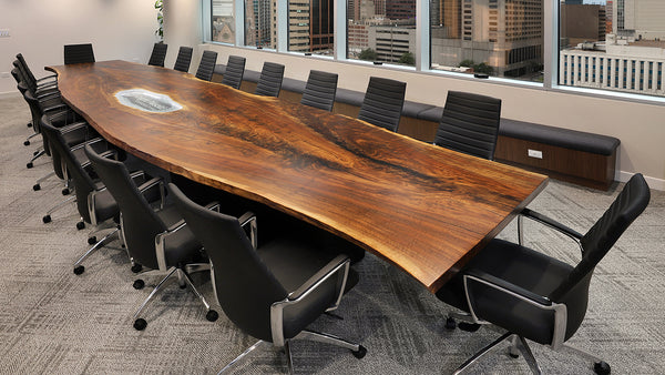 Custom Claro walnut slab conference table.