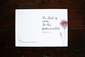 White greeting card with a watercolored clover flower and the verse: The Lord is near to the brokenhearted. Psalm 34:18