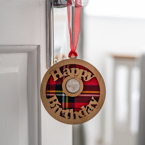 Hanging lucky sixpence with the words happy birthday.
