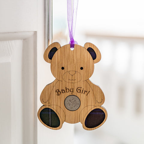Wooden bear hanging ornament with baby girl written on the front.