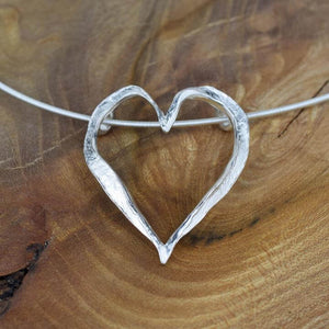 Close up view of open heart necklet