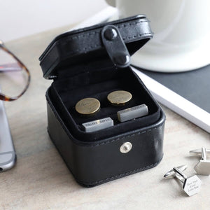 Black vegan leather cufflink box in travel size. It is shown open with cufflinks inside.