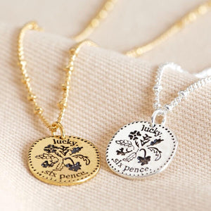 Lucky sixpence necklace in silver and gold options.