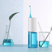 Load image into Gallery viewer, Water Flosser - Modern & Portable Water Flosser