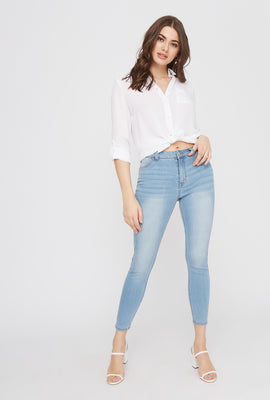 High-Rise Light Wash Distressed Jegging