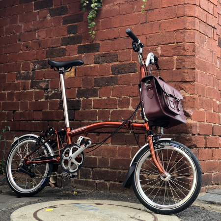 Brompton M6L Flame Lacquer 2019 folding bicycle parked outside