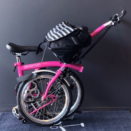 Brompton M6L Hot Pink 2019 foldable bicycle semi folded and attached bag