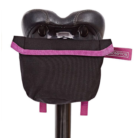 Black Brompton Saddle Pouch with Berry Crush-coloured straps - attached to saddle