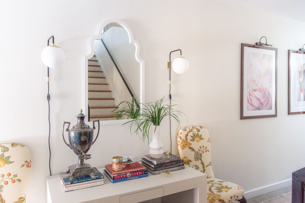 Entryway hall design with greige console table, wall mirror, sconces, and antique chair in modern townhouse design by Kevin O'Gara on Thou Swell #entry #entryway #entryhall #halldesign #hallwaydesign #entrydesign #interiordesign #townhouse #design