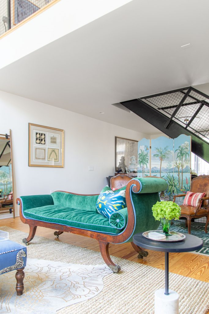 Antique chaise with green velvet upholstery and blue piping in modern living room by Kevin O'Gara on Thou Swell #livingroom #livingroomdesign #livingroomideas #antiques #furniture #design