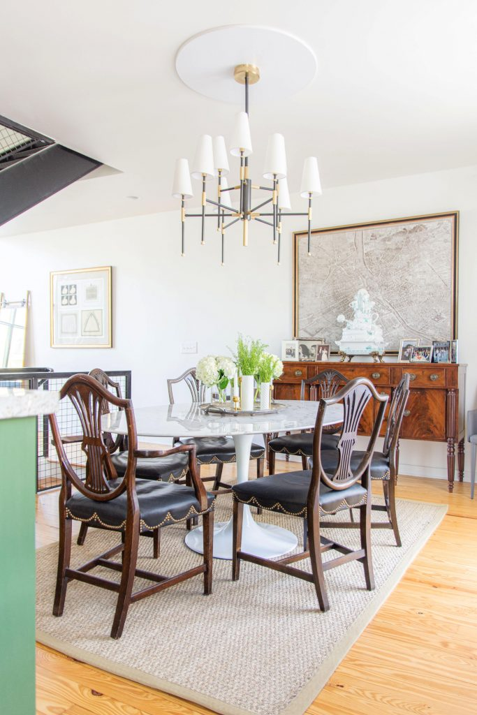 Dining room ideas with antique chairs, Saarinen tulip table, oval table, antique buffet dining room furniture, wood furniture in modern townhouse by Kevin O'Gara #diningroom #diningroomdesign #antiques #homedesign #interiordesign #homedecorideas