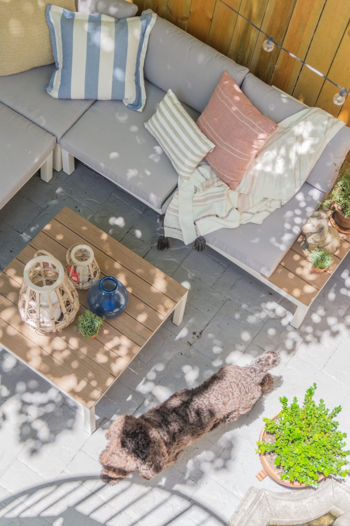 Spring patio design ideas with modern patio furniture sectional and potted garden on Thou Swell #patio #patioideas #patiodesignideas #patiodesign #patiofurniture #homedesignideas #patiodesignideas