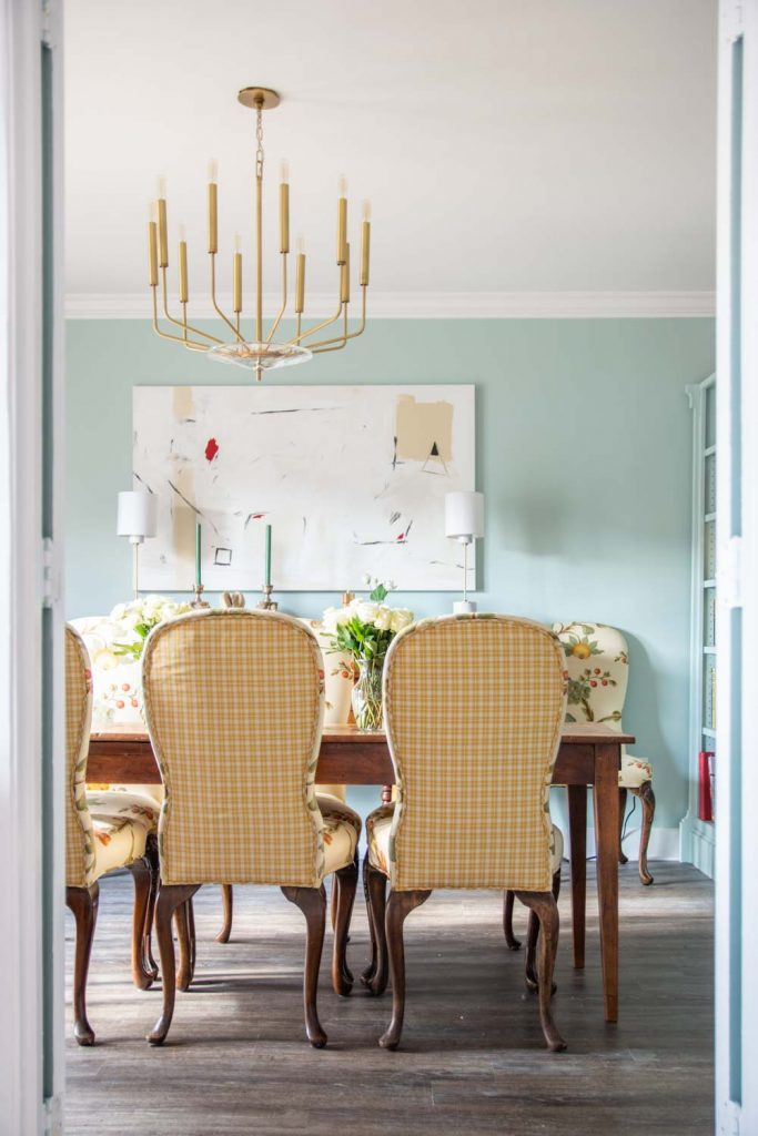 Light blue dining room with Clare Headspace paint color in Atlanta with antiques and modern Hudson Valley Lighting brass chandelier on Thou Swell #dining #diningroom #diningroomdesign #bluepaint #southernstyle #interiordesign #antiques