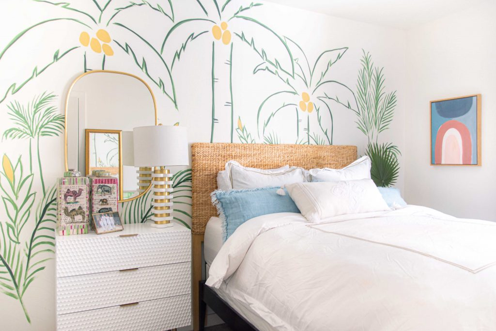 KILZ DIY painted tropical wall mural with palm trees using the Magnolia Home paint line in green and white, bedroom design by Kevin O'Gara on Thou Swell #wallmural #paintedmural #bedroomwall #bedroomdecor #bedroomdesign #tropicaldesign #tropicalwall #tropicalmural #diyproject #kilzpaint #magnoliahomepaint