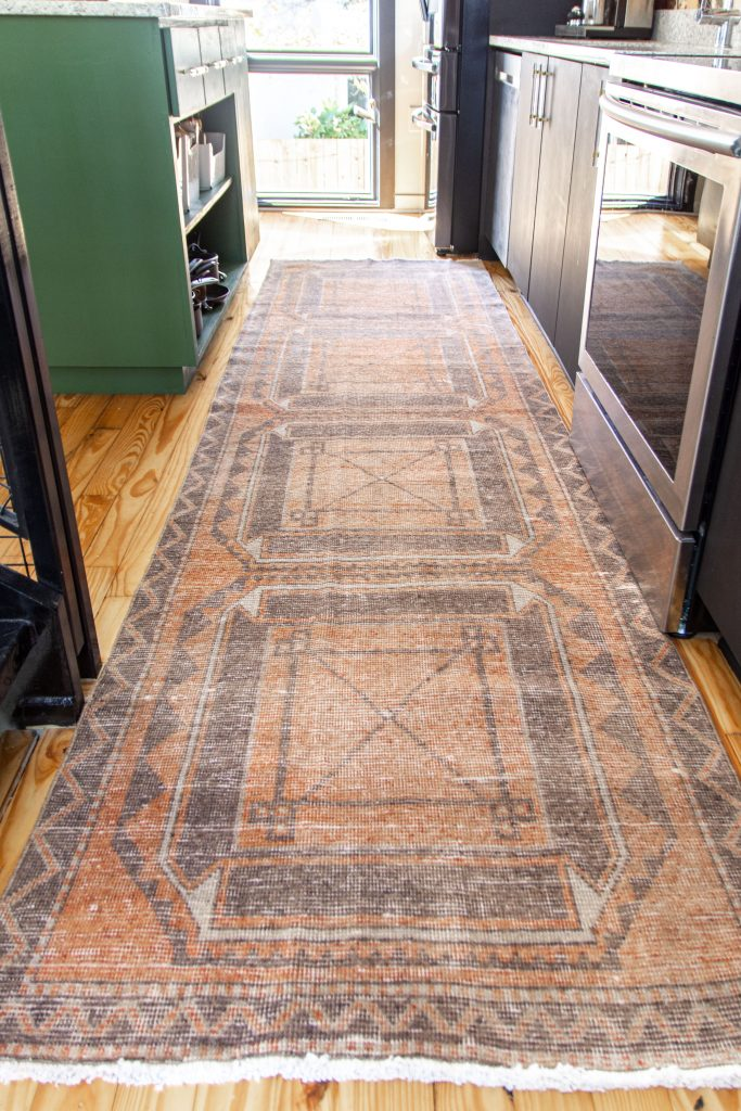 Vintage kitchen runner from Revival Rugs in modern kitchen design on Thou Swell #vintagerug #vintagerunner #kitchenrug #kitchenrunner #vintagekitchenrunner #kitchendesign #kitchendecor #kitchenideas #vintage #revivalrugs