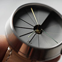 A closeup of the dimensional dial on a 22 Design watch