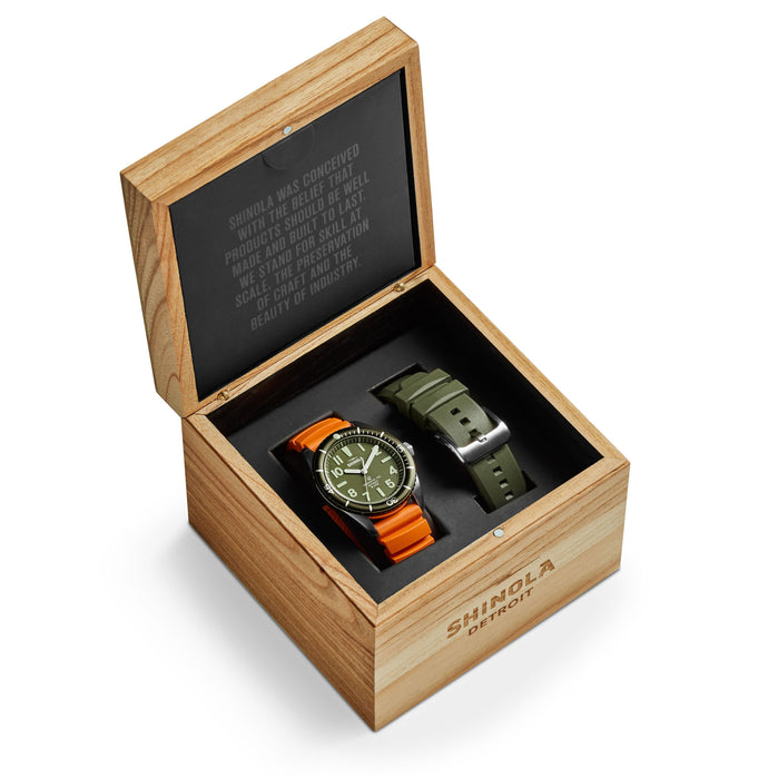 Shinola The Duck 42mm Orange Green angled shot picture